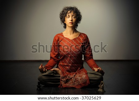 woman in yoga's lotus position - stock photo