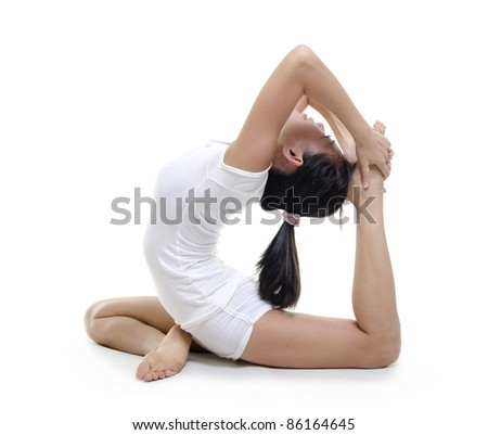 Woman in yoga, the pigeon pose, isolated on white. - stock photo