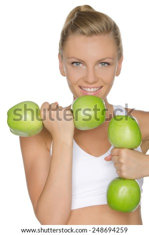 woman involved in fitness dumbbells of green apples - stock photo