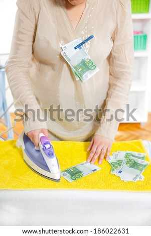 Woman iron money, money laundering concept