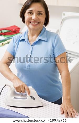 Woman Ironing Shirt - stock photo