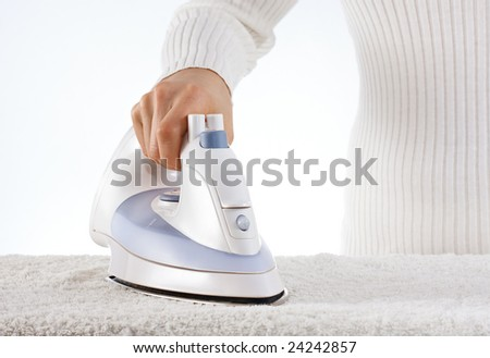 Woman ironing the towel - stock photo