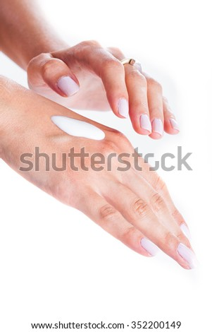 Woman is applaying moisturizing cream for hand care - stock photo