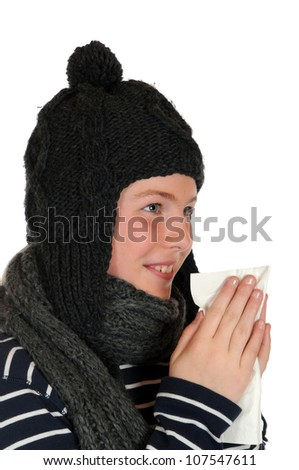 Woman is blowing her nose - stock photo