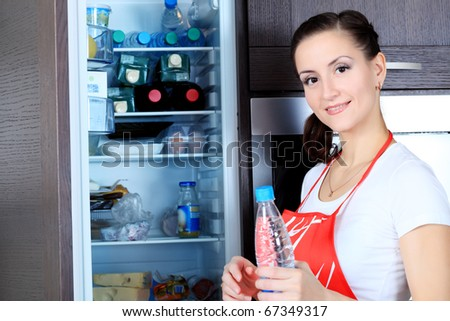 Woman is cooking on a kitchen at home. - stock photo