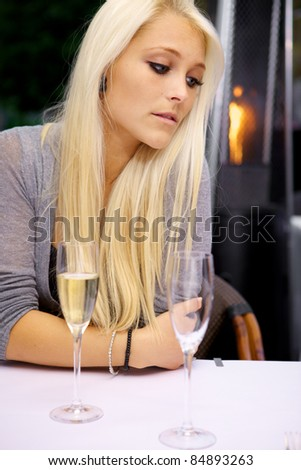 Woman is disappointed because her date is not showing up - stock photo