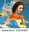 Woman is engaged aqua aerobics in water - stock photo