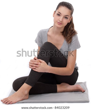 Woman is engaged in aerobics. On a white background. - stock photo