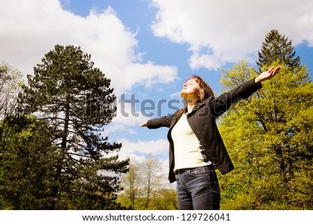 Woman is  enjoying her life outdoors among trees on sun - stock photo