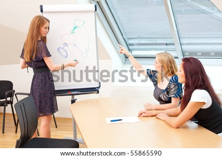 woman is explaining something to the new clients - stock photo