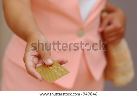 Woman is Giving a Gold Credit Card - stock photo