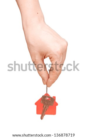 woman is handing a house key on a white background - stock photo