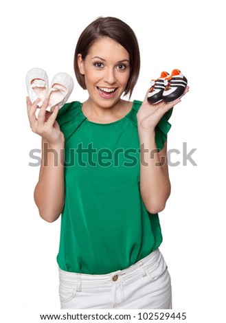 Woman is happy showing baby shoes - stock photo