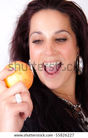 Woman is holding a apple - stock photo