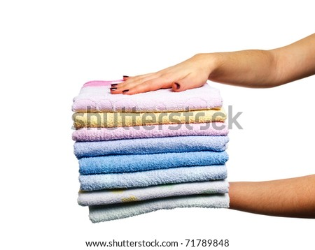 Woman is holding clean towels on a white background. - stock photo