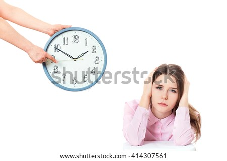 woman is holding in hands clock.