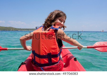 woman is kayaking - stock photo