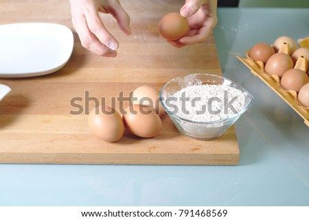 Woman is making cakes in the kitchen