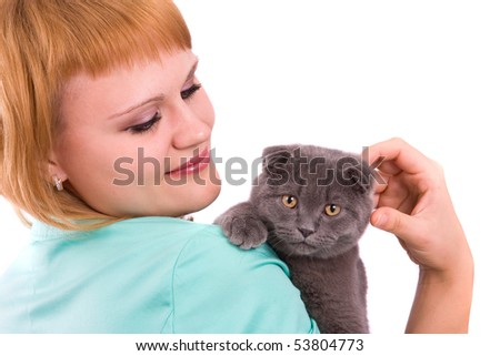 Woman is playing with scottish fold cat on white background.