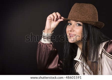 Woman is posing in a beautiful hat - stock photo