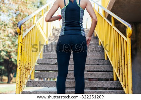 Woman is preparing to run up the stairs during the workout.
