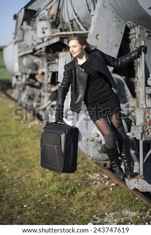 Woman is ready to jump off mowing train - stock photo