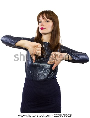 woman is shiny dress downvoting with thumbs down - stock photo