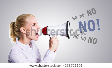 woman is shouting No through a megaphone - stock photo