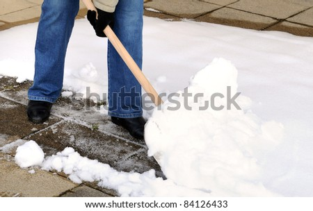 Woman is shoveling snow