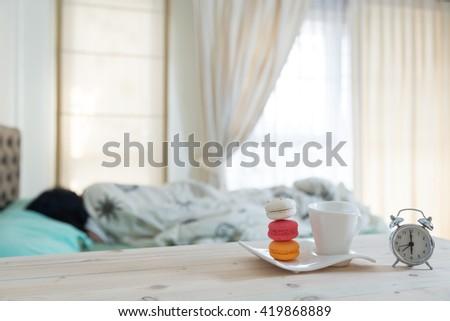 Woman is sleeping with Coffee and alarm clock - stock photo
