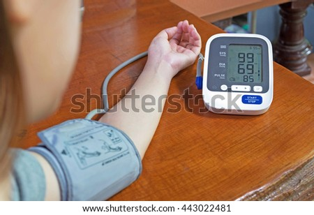 Woman is taking care for health with blood pressure