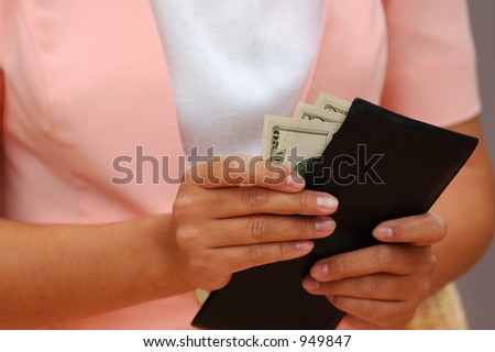 Woman is Taking Out Money From a Wallet - stock photo