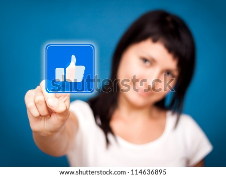 Woman is touching the like button - Social Media. - stock photo