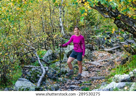 Woman is trekking in forest of Caucasus mountains in Georgia