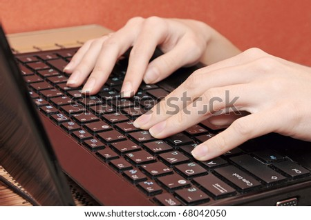 woman is typing the text - stock photo