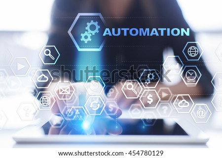 """Woman is using tablet pc, pressing on virtual screen and select """"Automation"""". - stock photo"""