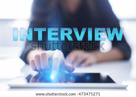 "Woman is using tablet pc, pressing on virtual screen and select ""Interview""."