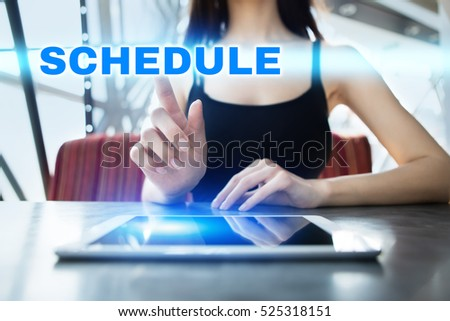 Woman is using tablet pc, pressing on virtual screen and selecting schedule.