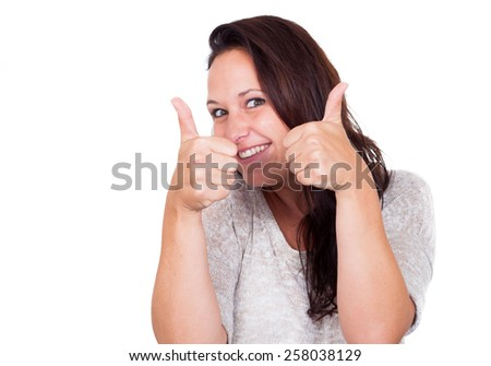 Woman is very happy and smiling because of winning - stock photo