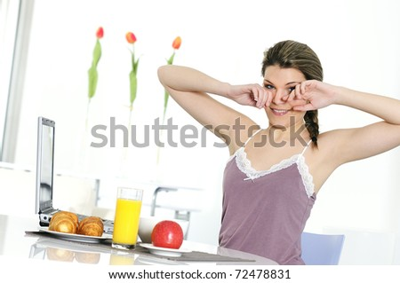 woman is wakup and having breakfast - stock photo
