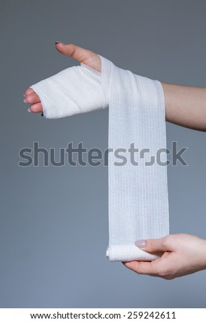 Woman is wearing bandage on her hand