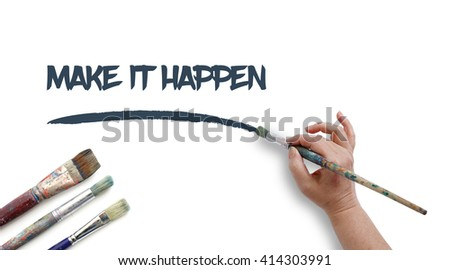 Woman is writing MAKE IT HAPPEN with paintbrush.