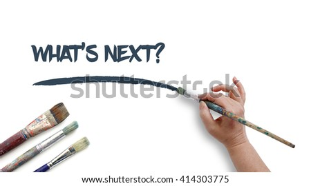 Woman is writing WHAT'S NEXT? with paintbrush.