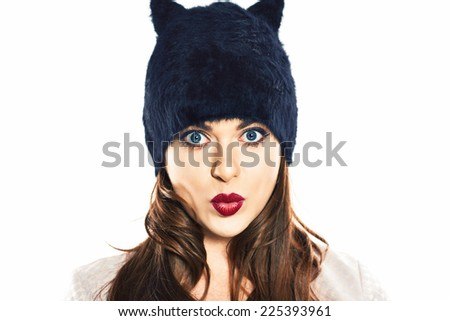 Woman isolated on white. Face portrait. Cap with animal ears.