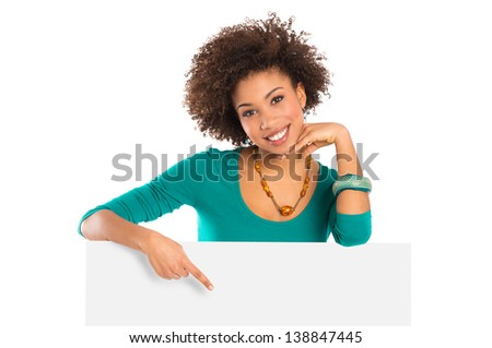 Woman Isolated Pointing On Billboard Over White Background - stock photo