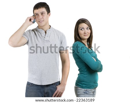 Woman jealous of a man talking on the phone - stock photo