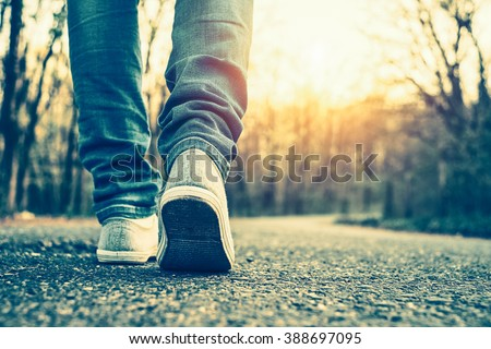 Woman jeans and sneaker shoes - stock photo