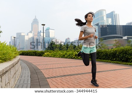 Woman jogging at outdoor - stock photo