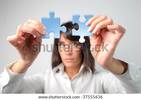 woman jointing two pieces of puzzle