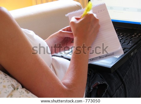 Woman jotting down ideas